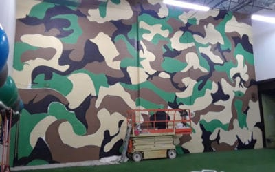 Camouflage Mural adds Grit to Company Gym