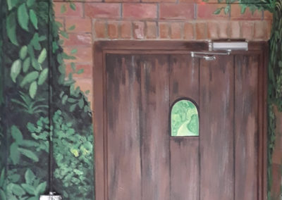 painted metal door with faux wood and ivy mural in Northern VA